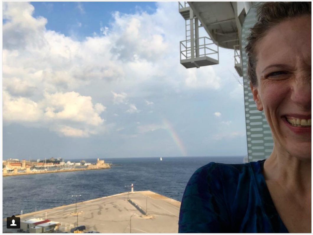 bonnie gillespie on balcony of cruise ship in rhodes greece